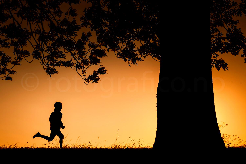 trim jogger solnrdgang løper silhuett